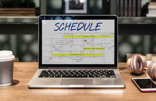macbook pro turned on displaying schedule on table